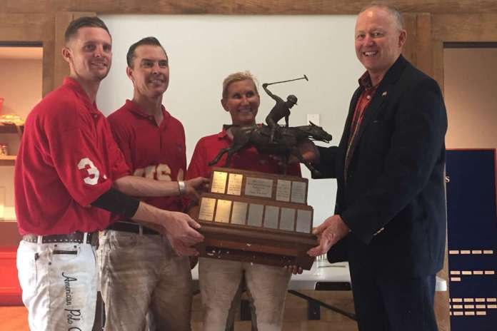 Victorious Marines capture a place on the perennial trophy - Chris Jones, Jake Flournoy and Shannon McGraw with event organizer Steve Walsh.