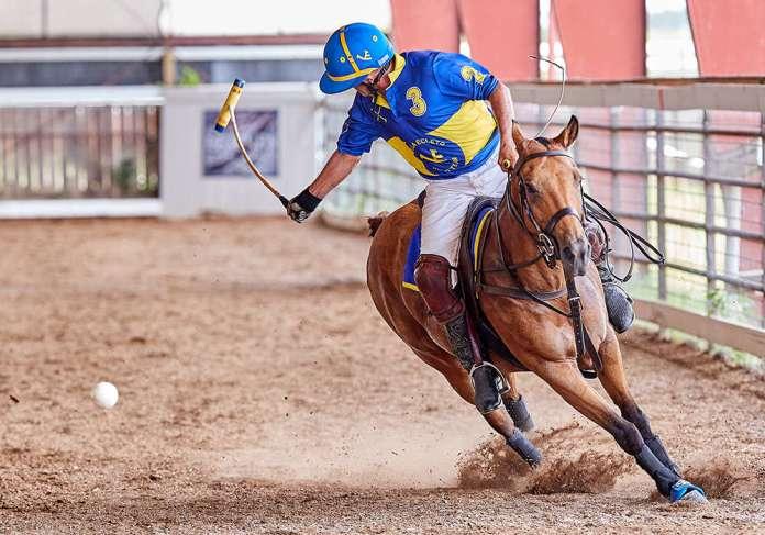 Villa Ecleto's Lalo Ramirez hitting a backshot on Best Playing Pony Layana.