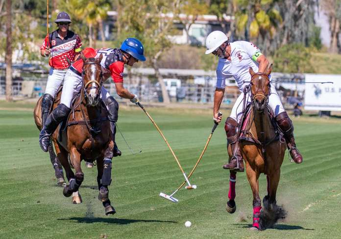 Sapa Polo's Jimmy Wright reaches for hook on Antelope's Santiago Trotz.