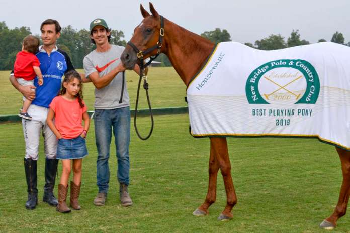 Lloret's fourth chukker chestnut mare Barbie received her second Best Playing Pony honor of the season, presented by Aiken Audiology. Pictured with Francisco Lloret, Caty and Huguito Lloret.