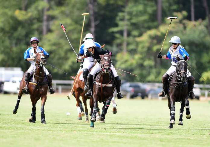 Hope Arellano carries the ball in front of Crossfit El Cid defenders.