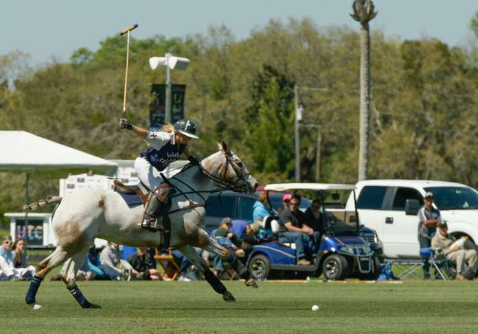 Belinda Brody, on her horse Feather, approaches the ball at full speed during the Sarasota Women's Challenge Final.