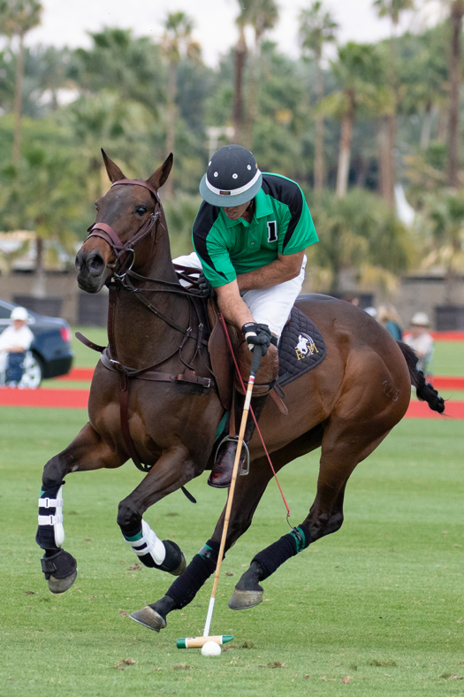 Danny Walker of Farmers & Merchants Bank carries the ball on the nearside riding Best Playing Pony Garrapinada.