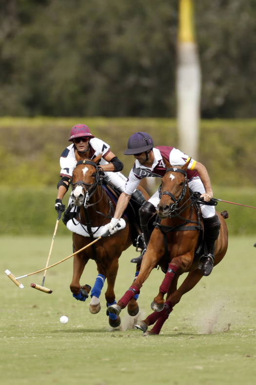 Dutta Corp's Timmy Dutta reaches for the hook on Pilot's Facundo Pieres.