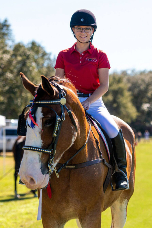 Director of Operations Paige Lautzenheiser rides Clydesdale Fisher, owned by George Alexander.