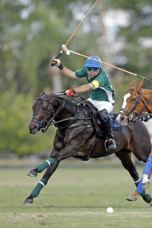 Sapo Caset and Popular race down field at top speed during the 2018 Ylvisaker Cup at International Polo Club Palm Beach. ©David Lominska