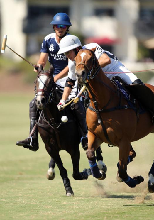 Rancho Polo/Chogan Alejandro Gonzalez hits a neckshot in front of defender Klentner Ranch's Jake Klentner.