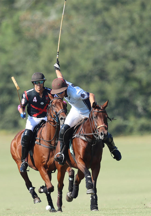 Orchard Pond-Un-Stable's Sterling Giannico riding Best Playing Pony Tequila, takes the ball downfield ahead of La Bourgogne's Alan Martinez.