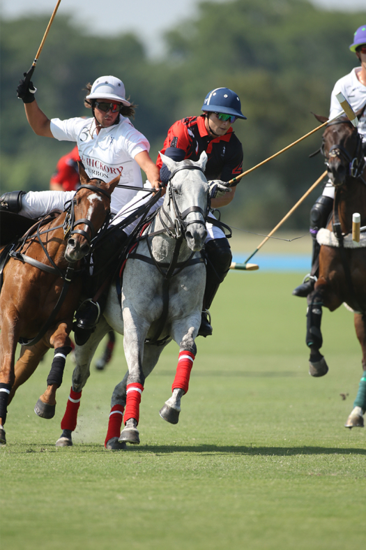 Postage Stamp Farm's Matias Gonzalez preparing to play the ball on the nearside under pressure from Old Hickory Bourbon's Santino Magrini.