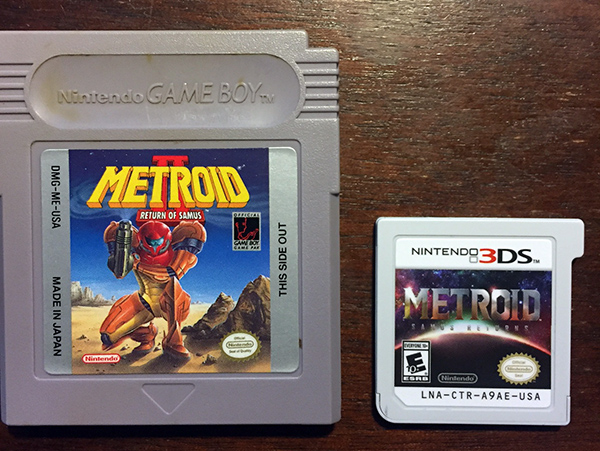Photo of gameboy game Metroid II Return of Samus next to 3DS cartridge of Samus Returns