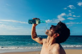 thirst man on beach drinking water
