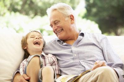 elderly man spending time with grandson
