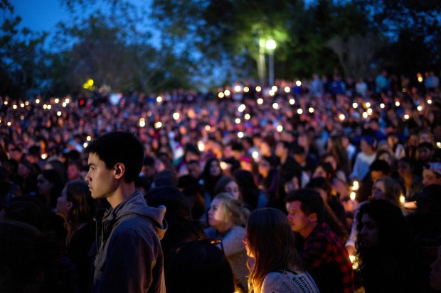 People gather at a park for a candlelight vigil to honor the victims of Friday night's mass shooting on Saturday, May 24, 2014, in Isla Vista, Calif. Sheriff's officials say Elliot Rodger, 22, went on a rampage near the University of California, Santa Barbara, stabbing three people to death at his apartment before shooting and killing three more in a crime spree through a nearby neighborhood. (AP Photo/Jae C. Hong)