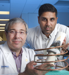 Dr. David Greenberg, left, and Dr. Rajiv Chopra have shown that a coil magnet wrapped around a prosthetic knee can destroy bacterial biofilm on the artificial knee.
