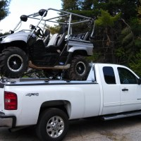 Stretched Yamaha Rhino Atop UTV Hauler on Silverado Pulling Trailer