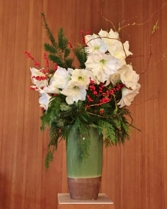 Arrangement with white flowers and cedar and fir twigs
