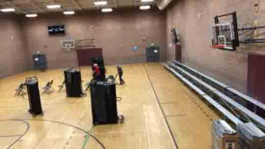 "Sunday morning ""Roadies"" setting up chairs in the Meadowbrook gym"