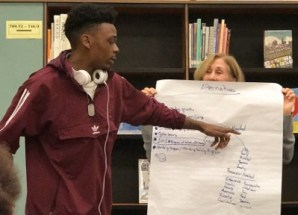 Lonzell points to notes on a flip chart