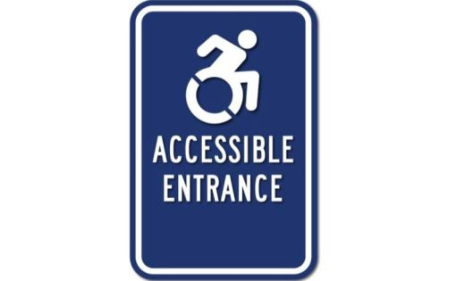 "Sign showing wheelchair icon and reading ""Accessible Entrance"""