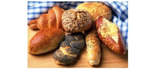 Seven small loaves of bread of different kinds