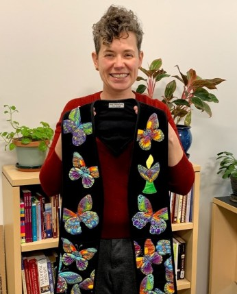 Rev. Beth Chronister holding her butterfly stole