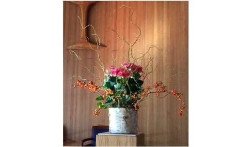 Flower arrangement with pink and orange and curly willow