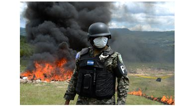 Soldier in front of black smokey fire