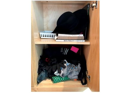 Lost and Found item in cabinet (hat, books, gloves, umbrella,...)