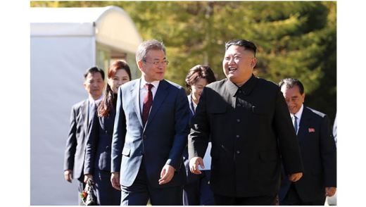 SAMJIYON, NORTH KOREA - SEPTEMBER 20: North Korea's leader Kim Jong Un (R) walk with South Korean President Moon Jae-in (L) during a visit to Samjiyon guesthouse in Samjiyon on September 20, 2018 in Samjiyon, North Korea. Kim and Moon meet for the Inter-Korean summit talks after the 1945 division of the peninsula, where they will discuss ways to denuclearize the Korean Peninsula. (Photo by Pyeongyang Press Corps/Pool/Getty Images)