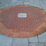 Red, engraved bricks, formed in a circle