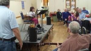 Small girl on stage playing ukelele