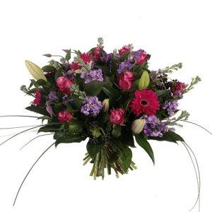Boeket roze en paarse tinten | Boeket Christel | Uwbloemenman.nl