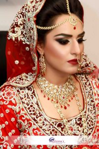 An Asian bride from UK with red themed Asian Bridal Makeup and Traditional Red Wedding Dress