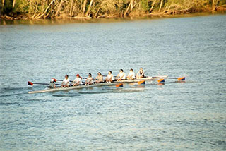 Photo of Jen Clark rowing with a rowing team