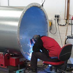 Welder in action on rotator