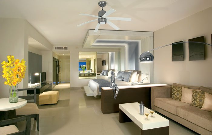 Junior Suite at Secrets Silversands Riviera Cancun features a suspended king size bed or two queen size beds and a double Jacuzzi.