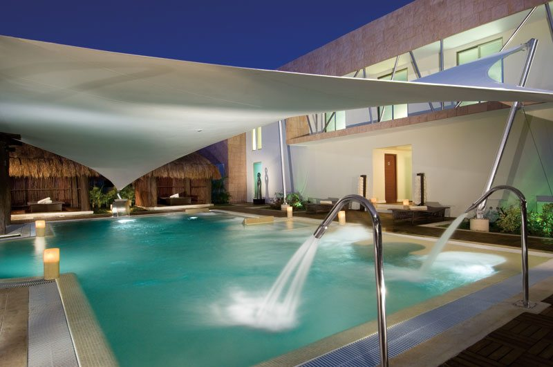The Secrets Spa by Pevonia luxurious open-air pool with a water circuit area.