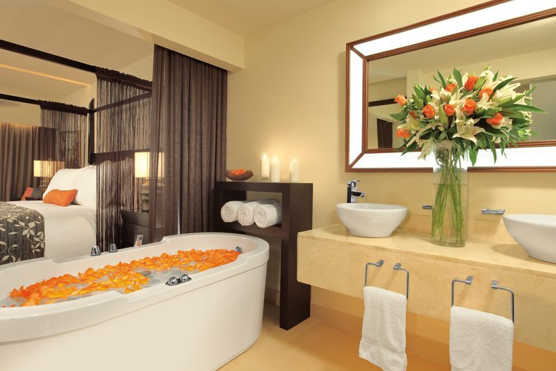The Junior Suite bathroom offering dual vanities, spacious bathtub and a separate shower