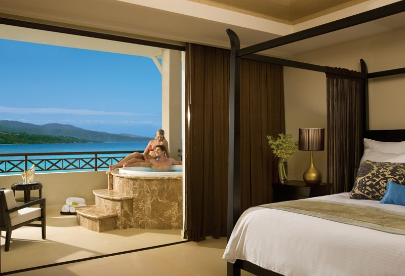 The Preferred Club Master Suite Ocean Front is complete with a separate living and dining area, a king bed and a large balcony with Jacuzzi for two