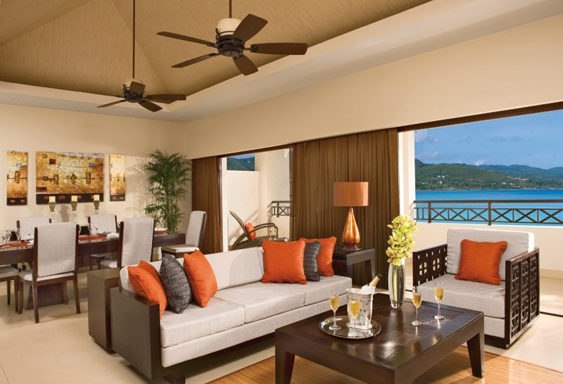 The living room of the Presidential Suite offers an expansive balcony showcasing fabulous views of the Caribbean