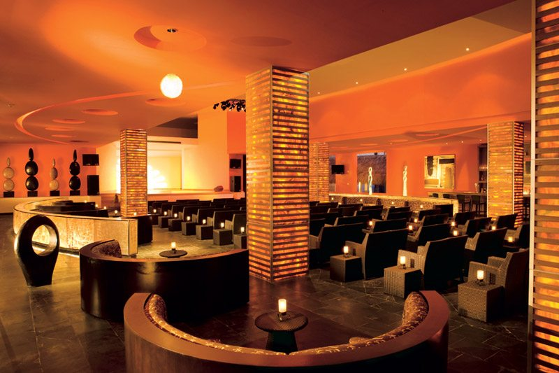 The contemporary decor of the theatre offers a unique atmosphere to enjoy live nightly entertainment.