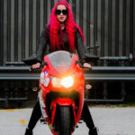 Young Money: This millennial takes odd jobs and travels North America on her motorcycle