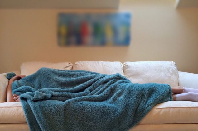Women sleeping on a couch