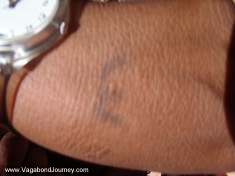 of the hand poked tattoo lines and dots that adorned her hands and face.