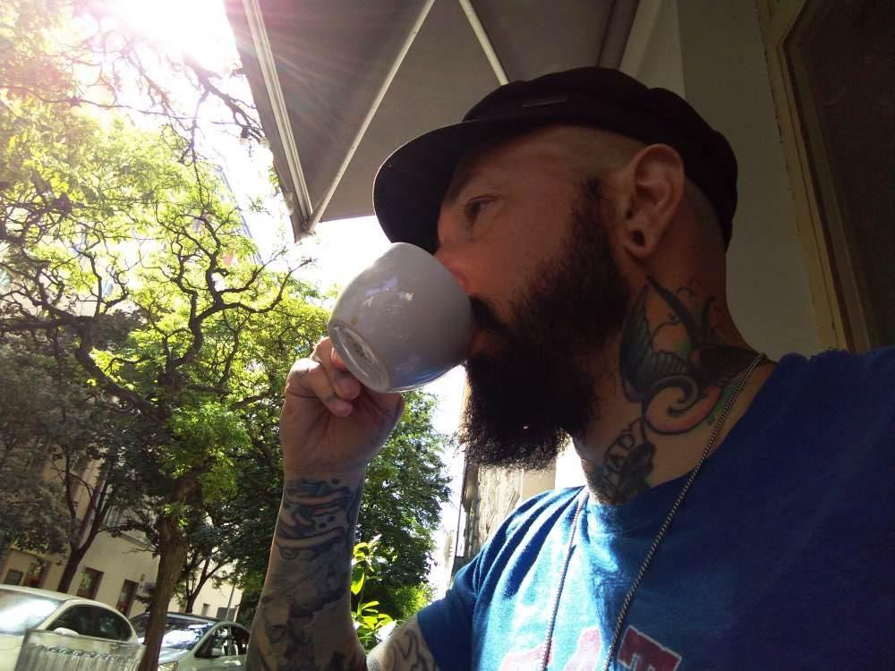 Wade Shepard drinking coffee in Prague