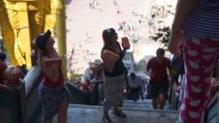 Tourists carrying bricks
