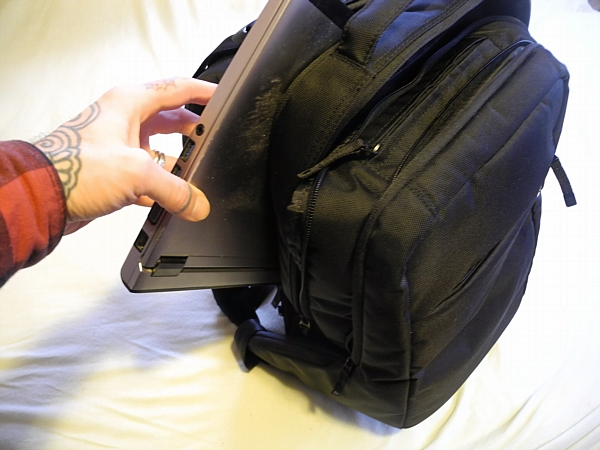 Compartment for a laptop.