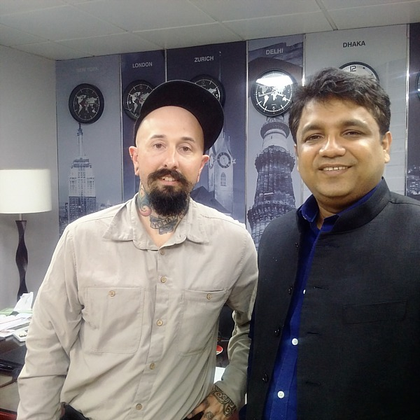 Wade with an exec from The Asian Age newspaper in Dhaka.