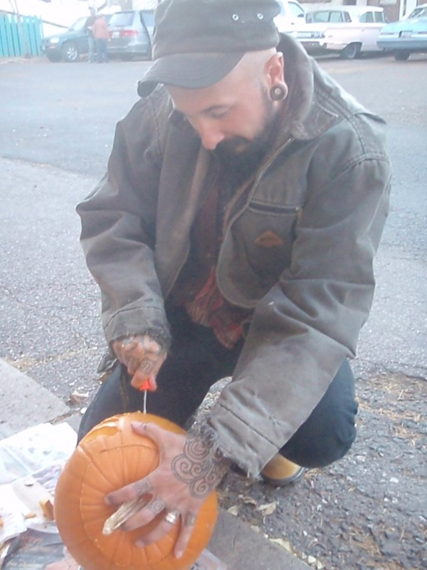 Wade carving a pumkin for Halloween in Flagstaff