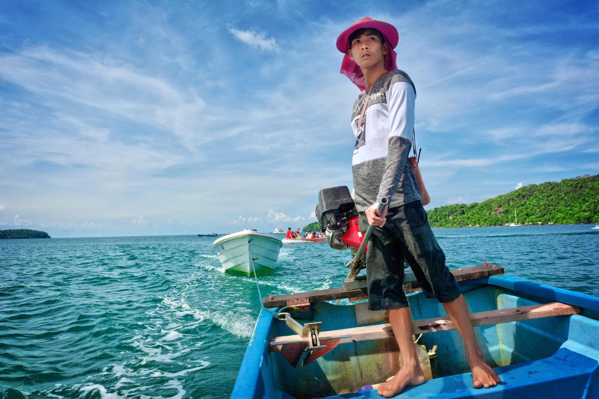 Cambodia boat woman